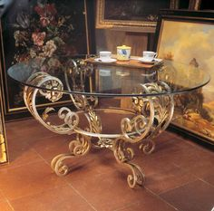 Ornate wrought iron and glass coffee table by effebiweb.com
