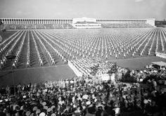 """Mass gymnastics were the feature of the """"Day of Community"""" at Nuremberg, Germany on September 8, 1938 and Adolf Hitler watched the huge demonstrations given on the Zeppelin Field."""