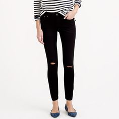 "Our skinniest style, the toothpick is lean, cropped and a little bit sexy (and it's the pair we're most likely to tear our closet apart looking for). We updated this pair with ripped knees and a faded black wash that makes us feel sleek and cool—even when we wear them with our boyfriend's sweatshirt. <ul><li>Sits on hips.</li><li>Fitted through hip and thigh, with a superskinny, ankle-length leg.</li><li>28"" inseam.</li><li>10 1/4"" leg opening (based off size 28).</li><li>Cotton/poly with…"