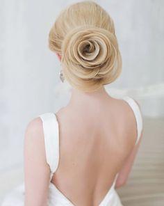 Elegant updo wedding hairstyle; via Elstile