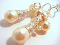 $35 Czech glass pearls and silver plated copper wire. http://www.artfire.com/ext/shop/product_view/amijusartdesign/423538/when_im_coming_to_your_room/handmade/jewelry/earrings/shell_pearl