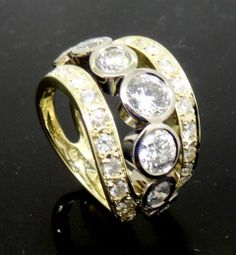 Fabulous Double rail Diamond Set Dress Ring with bezel set Diamonds through the centre, hand made by Peter Kumskov incorporating Diamonds and gold from old jewellery. Set your imagination free at 'My Own Jeweller Direct' in Brisbane.  http://jewellerdirect.com.au/image/data/Gallery/Diamond%20rings/Diamond-Three-Band-Dress-Ring-web.jpg