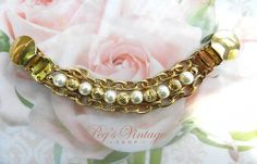 Check out this item in my Etsy shop https://www.etsy.com/ca/listing/560931457/1960s-vintage-gold-tone-white-faux-pearl
