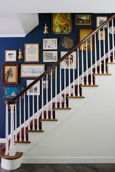 Benjamin Moore Washington Blue stairwell wall with art and white stairs. wall Blue and Red Entrance Painted in Benjamin Moore Washington Blue Stairway Gallery Wall, Stairwell Wall, Stairway Walls, Staircase Wall Decor, Stair Art, Stair Gallery, Gallery Wall Bedroom, Staircase Design, Picture Wall Staircase