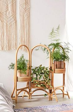 With a trio of panels this looped rattan planter displays your favorite little blooms  ferns with fresh boho style. Hinging structure at each panel folds in and a platform along each panel at different levels holds your planter of choice complete with arched motifs at top  base. Tucks away into itself for easy storage. UO exclusive. Content  Care    Rattan    Wipe clean    Imported   Size    Dimensions 39.63l x 11.88w x 33.5h    Closed dimensions 13.5l x 13w x 33.5h    Shipping dimensions… Indoor Plant Shelves, Indoor Plants, Bohemian Living, Bedroom Plants, Bedroom Decor, Rattan Planters, Rattan Basket, Wicker, Farmhouse Side Table