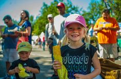 Children eating corn on the cob during Taste of Colorado festival, another not-to-miss Denver festival, held annually Labor Day weekend. Photo Credit: Evan Semon and VISIT Denver