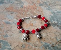 Red glass bead with silver detail and 2 silver Buddhas head charms, handmade with lobster clasp by SpryHandcrafted on Etsy Handmade Beads, Handmade Bracelets, Beaded Bracelets, Red Glass, Rose Quartz, Glass Beads, Copper, Bronze, Pearls