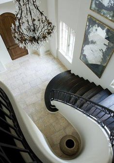 Suzie: Melanie Turner Interiors - Elegant dramatic winding staircase design with bronze crystal ...