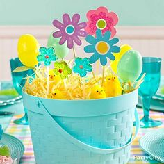 A tisket, a tasket, a centerpiece basket!  What better way to show spring has sprung than with a basketful of chicks and daisies?