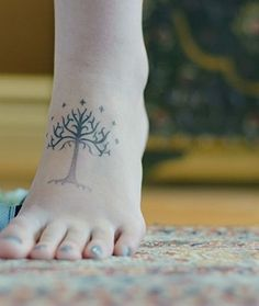 "Beautiful ""White Tree of Gondor"" tattoo by swiftandspotlitstrangers."