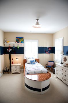 very creative nautical room for a boy, it even has a boat-bed!