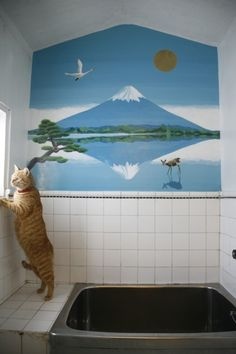 A relaxing bath:  When humidity gets you down, the bath is your escape. Go from tired and sweaty to cool and rejuvenated!  Notice the cool colors and simple lines of the mural, which brings a thematic element into the room to unify it with the rest of the house. Natural light, characteristic of Japanese bathrooms, makes the room refreshing. Not to mention, there is a cat by the bathtub.