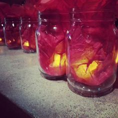Red Mason Jar Lanterns.   I created these using LED tealight candles enclosed in red tissue paper. Created a beautiful glow on the tables .  You can buy Best LED Tea Light in the market http://www.amazon.com/BEST-FLAMELESS-TEA-LIGHTS-Pack/dp/B00HAQUI4A/ref=cm_cr_pr_product_top