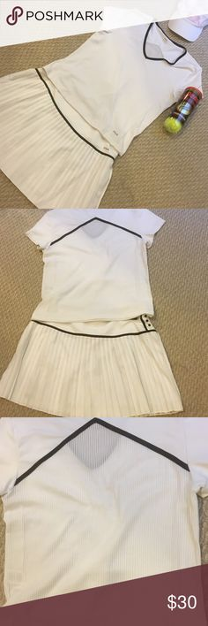 Fila Tennis Outfit There is no need to give up your style while on the tennis court.  This Fila outfit is great with the full pleated skirt.  The top looks ordinary on the front but the back has beautiful white ribs that are almost sheer.  Both pieces are being sold as a set.  Like new...  Great bargain! Fila Other