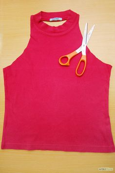 How to Make a Halter Top. Halter tops are fun, flirty shirts with open backs that tie behind your neck. Instead of purchasing a halter top from a department store, devote an afternoon to creating your own. Recycle your clothes and. Zerschnittene Shirts, Cut Up Shirts, Band Shirts, Shirt Makeover, Diy Halter Top, Halter Tops, Teen Crop Tops, Diy Clothes Refashion, Diy Clothes Videos