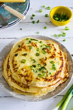 In season in April - spring onions. Looking for a tasty alternative to pitta bread or tortillas? How about these tasty looking spring onion pancakes? #food #recipe
