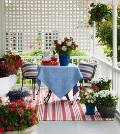 Add flowering plants, pillows, a tablecloth and striped rug in red, white, and blue, hang some twinkle lights, and your look is complete.