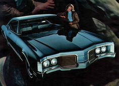 I've been using this as a wallpaper for my phone.  From the full line brochure for the 1968 Oldsmobile lineup, the Delta 88 Holiday coupe...