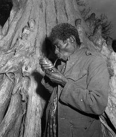 Aged black Seminole smokes from his pipe: Everglades, Florida by State Library and Archives of Florida, via Flickr