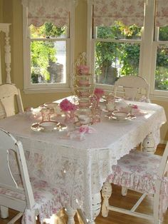 Love the chair pads and window shades... wish I had some of that pink glass! Cute napkin ring for the ultimate shabby chic table.