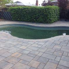 This beautiful backyard was created by Richmond County Stucco & Stone using Cambridge pavers.