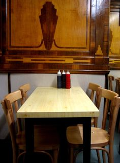 E. Pellicci cafe, Bethnal Green Rd. Lovely Italian marquetry inside.