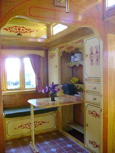Living area showman wagon w/ mollycroft. Like the storage area under where the table folds down.