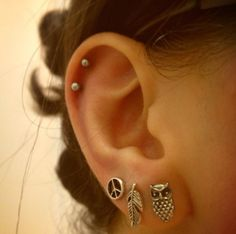 triple lobe and double helix piercing