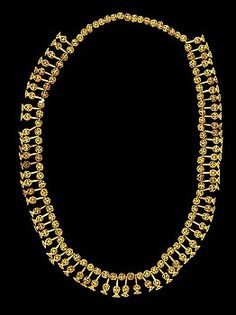 Gold necklace from the Egyptian 19th Dynasty This collar was found in an unfinished chamber in the Valley of the Kings, KV 56, with other objects bearing the names of Ramses II, Seti II and Tausret. The filigree collar is composed of pendants in form of lilies, which alternate with small balls. All the components are made of gold. Another group of components of the same collar is on display in the Metropolitan Museum of New York.