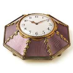 An unusual silver-gilt and enamel desk clock by Carl Faberge, decorated with rich purple guilloche enamel.