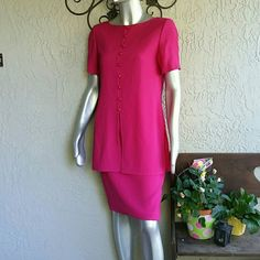 Pretty Pink 2psc Tunic Suit by Liz Claiborne Brand Liz Claiborne  Size 4 Both pcs 70% Acetate 30 % Polyester  Upper Tunic style with string hook style button up. Buttons have gold beaded centers, side slits., short sleeve, shoulder pads.  Pencil style Midi Skirt zipper back with Elastic for flexible fit. Slit back. Lined Originally  $129.00 perfect condition and will be home dry cleaned before it's journey  Bundles available with discounts Liz Claiborne Dresses Midi