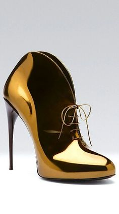These are pretty much like finding a pot of gold. Gold Gucci shoe
