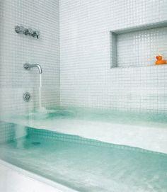 clear glass bathtub