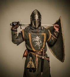 Typical look of a 12 -14th century knight with an arming sword and a heater shield. Chainmail did not begin to be replaced by plate armor un...