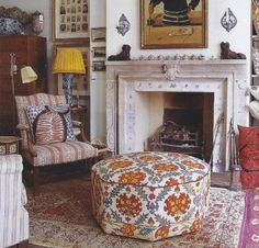 Robert Kime | Warm tonal textiles make your living room design welcoming and cozy, beautiful upholstered ottoman and oriental rug.