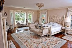 French-inspired designs make this stunning bedroom so feminine. Yes, lock me in the room please! No need to go outside when you have a room this gorgeous to roll around in!
