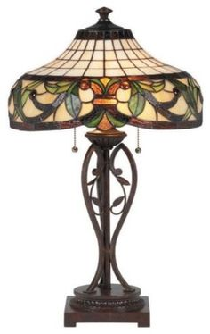 A Tiffany lamp is a lamp with a glass shade made with glass designed by Louis Comfort Tiffany and his design studio. The most famous were the stained leaded glass lamps. Tiffany lamps are considered part of the Art Nouveau movement.