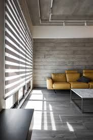 If you are creating your minimalist living-room, it is best that you let the natural light enter in the space, by keeping your windows dressing easy.