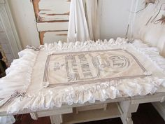 Handmade white ruffled runner or tablecloth, vintage and new fabrics in white with antique feed sack embellishment anita spero design