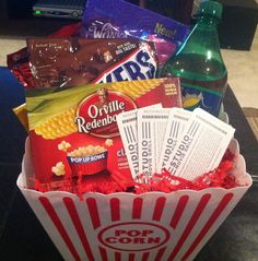 Tenant lease renewal movie gift basket. Snacks, popcorn, 1 liter Sprite, and 4 Studio Movie Grill tickets. Made this as a gift for renewing lease.