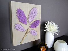 Use a hammer, nails, and your favorite yarn to make this cute wall art!