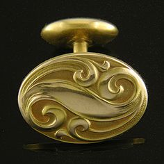 A tangle of sensuous scrolls enlivens these Art Nouveau cufflinks from the turn of the last century.  The tight, twisting swirls are characteristic of Art Nouveau jewelry created in America.  Created by Link & Angell in 14kt gold, circa 1900.