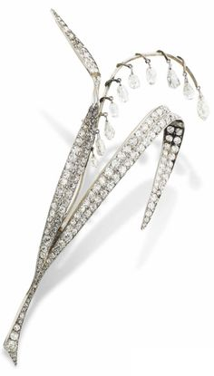 A LATE 19TH CENTURY DIAMOND BROOCH. Modelled as a stylised spray of Lily-of-the-Valley, the curling leaves pavé-set with old-cut diamonds, aside a central frond of briolette-cut diamond drops, detachable brooch fitting, circa 1890, French assay marks for gold, maker's mark indistinct possibly EF for Fouterman. #antique #brooch