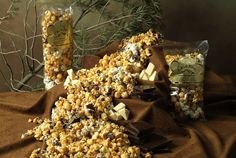 A Rocky Mountain avalanche of white and dark chocolate hand drizzled over sweet caramel corn!