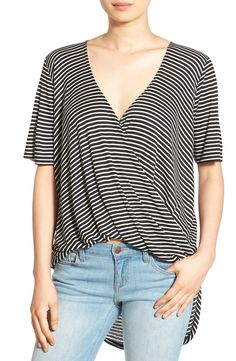 Crisp stripes and a plunging surplice neckline define this slouchy rib-knit tee with a dramatic high/low hem.
