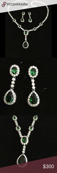 Simulated Emerald & Clear CZ Necklace&Earrings Set Necklace: - Drop has prong-set, oval simulated emerald in frame of bead-set, round, clear CZs - Bezel-set, round, clear CZs connect to pear-shaped dangles, round, clear CZs - Trios of bezel-set, round, clear CZs space oval stone stations on drape - Bezel-set, round, clear CZs complete necklace    Earrings:  - Post has prong-set, oval simulated emerald in frame of bead-set, round, clear CZs - Dangle has bezel-set, round, clear CZs that…