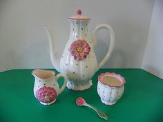 Decorative ceramic teapot with matching creamer, sugar  spoon