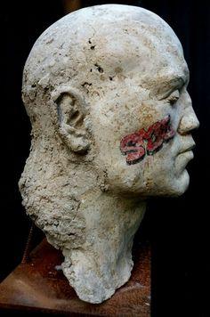 #Cast #concrete, rusted #metal, oil paint #sculpture by #sculptor Marc Bodie titled: 'S.M.E. (Secret Means of Escape Strong Male statue)'. #MarcBodie