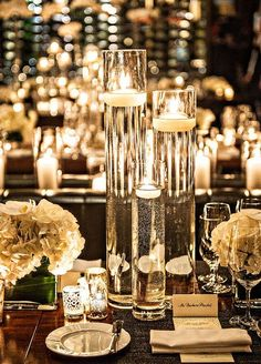 winter floating candles wedding centerpiece idea / http://www.deerpearlflowers.com/wedding-ideas-using-candles/
