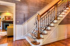Traditional Staircase with Carpet, Wainscoting, High ceiling